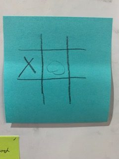 A tic-tac-toe board with an X in the left middle square and an O in the center square.