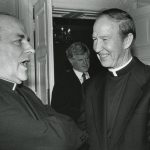 Father Monan speaking with Tomas Cardinal O'Fiaich at a state dinner