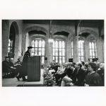 Fr. Monan speaking in Bapst Library.