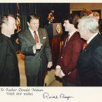 Father Donan with Ronald Reagan, Doug Flutie, and Silvio Conte