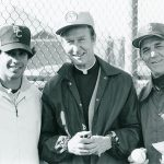 Father Monan with baseball coaches