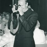 Father Monan with camera