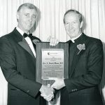 Father Monan receiving an award