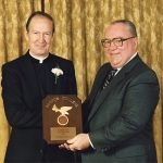 Father Monan at his induction into the Boston College Hall of Fame in 1985