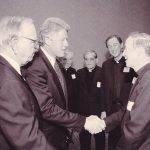 Fr. Monan and Bill Clinton