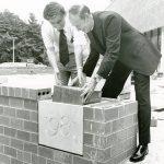 Father Monan laying a cornerstone