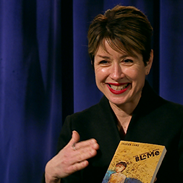 Mary Sherman holds up her book during her interview