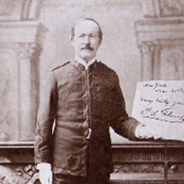 Photo of P.S. Gilmore standing near sheet music