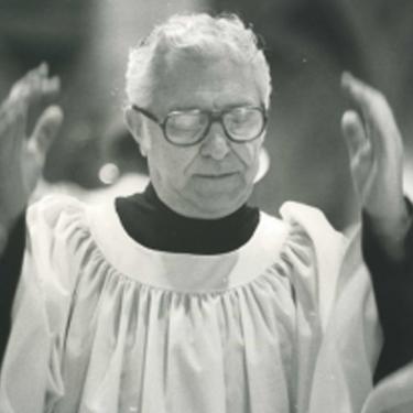 Photo of Theodore Marier conduction choir