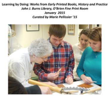 Librarian Barbar Hebard works with students to create a book binding