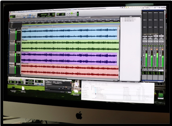 Pro Tools audio digitizing software showing a visual representation for part of recording of a 78-rpm record. Different colors represent different tracks.