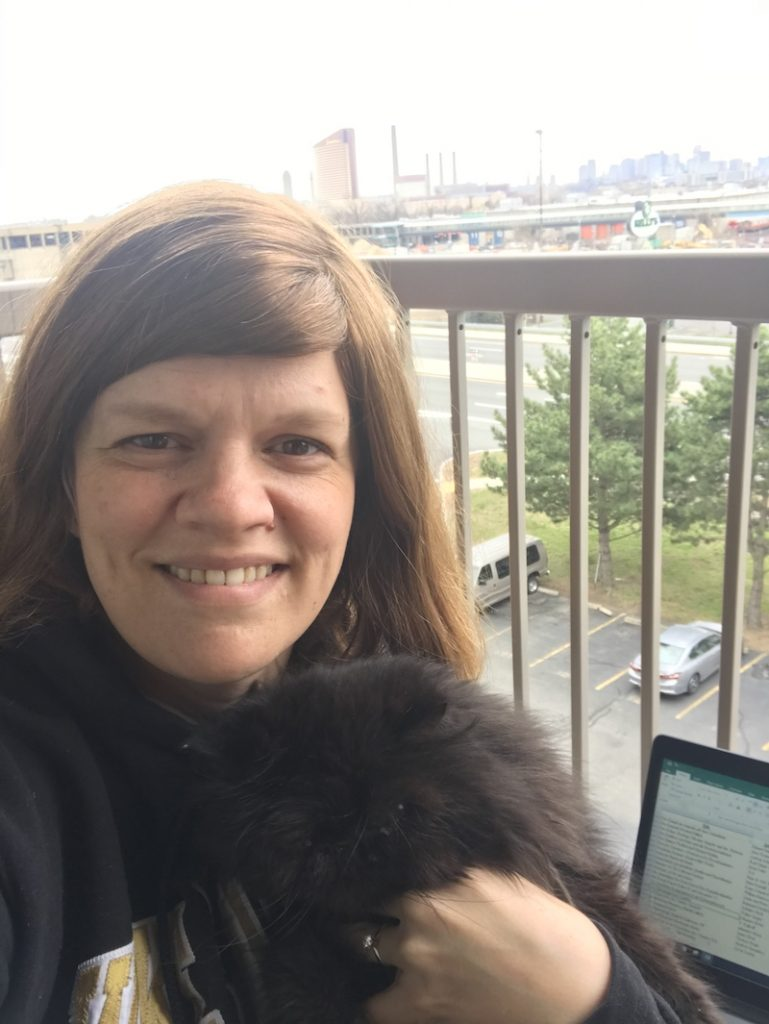 Jen Butler, Senior Research Librarian/Bibliographer, Theology & Ministry Library, taking a cat-break with Samson while working from home in her nice weather work space.