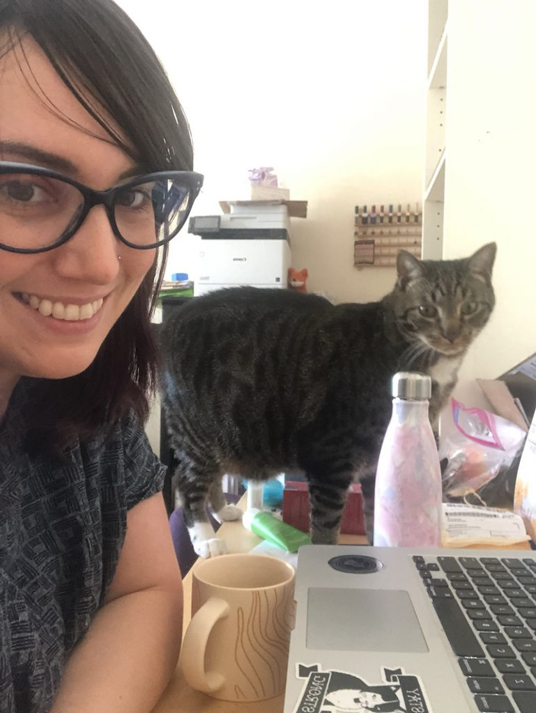 Sarah Melton, Head, Digital Scholarship, keeping digital library initiatives running under the watchful supervision of her cat, Chimera.