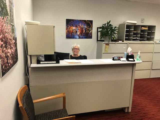 Mary Lafferty, Administrative Assistant, keeping the administrative office in O'Neill Library running on time.