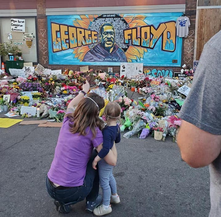 Mother showing her young daughter the mural and shrine for George Floyd in Minneapolis, June 2020. Photo credit: Kate Kipling