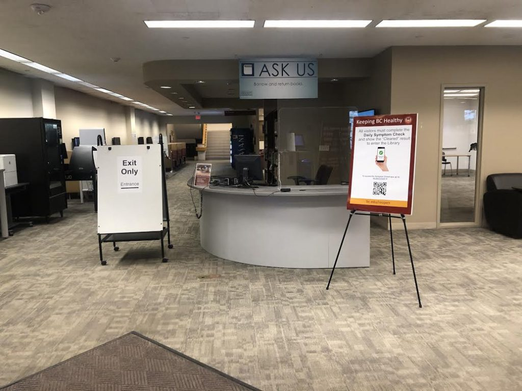 "O'Neill Library level 1 service desk with ""Exit Only"" routing signage"