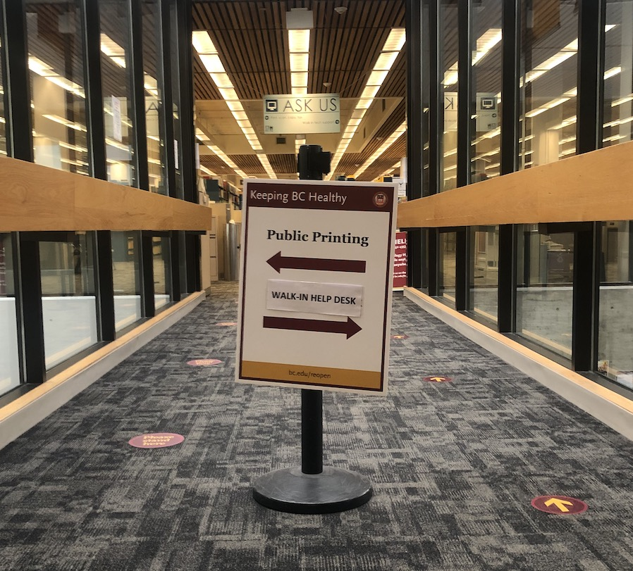 Directional sign for printing and Walk-in Help Desk, O'Neill level 3 atrium, with an arrow pointing right for the Walk-in Help Desk and another arrow pointing left for public printing.