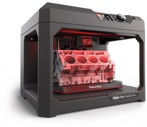 Image of MakerBot Replicator 3-d printer, with a sample 3-d object.