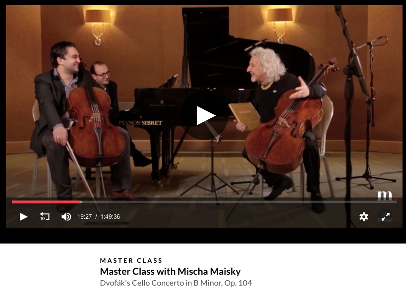 Still image from medici.tv master class with Mischa Maisky, showing the cellist laughing with two students, a cellist and pianist.