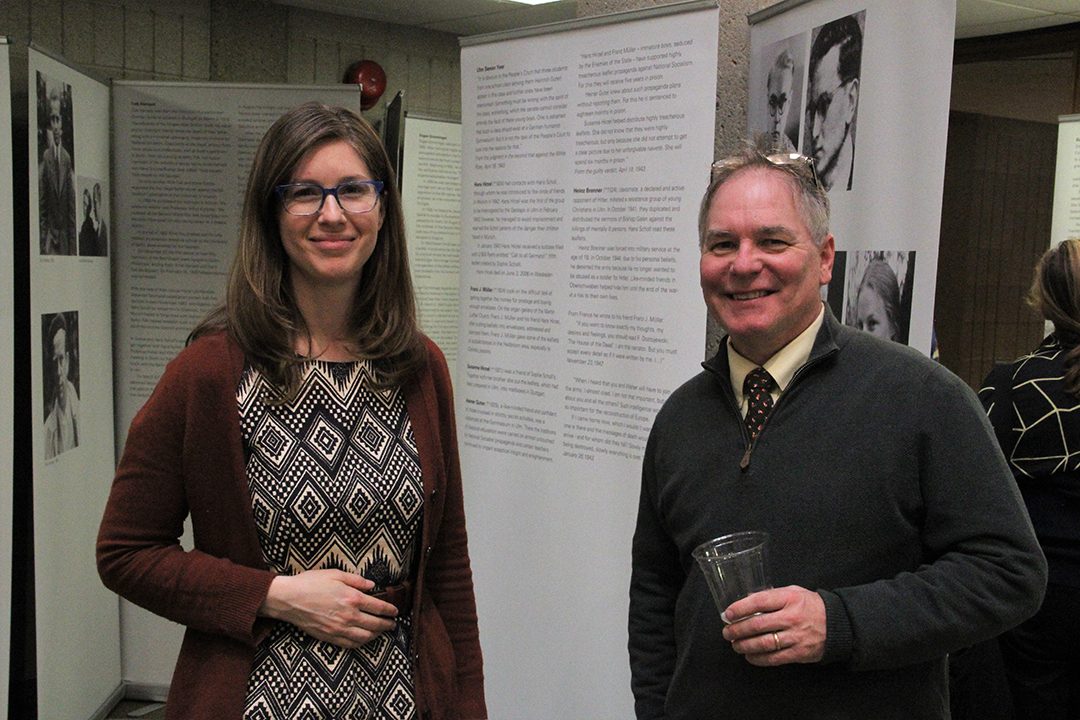 Students and faculty viewing the exhibit during the opening reception