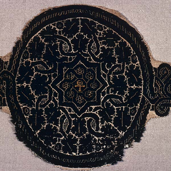 Textile roundel with interlace