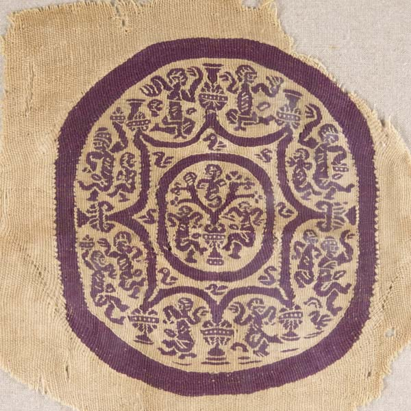 Textile roundel with eight-pointed star, tree of life, dancing figures