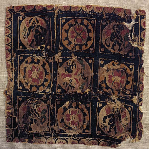 Textile fragment with roundels, tree of life, flowers, Eros figures