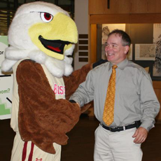 University Librarian Tom Wall shakes hands with Baldwin Eagle.