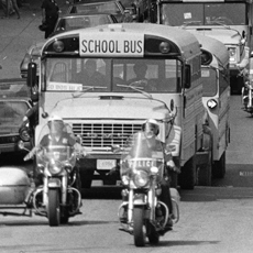 Photo of school buses bringing desegregated children to school